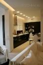 ob092 Кухня, гостиная и лоджия объединены одним видом классической венецианской штукатурки